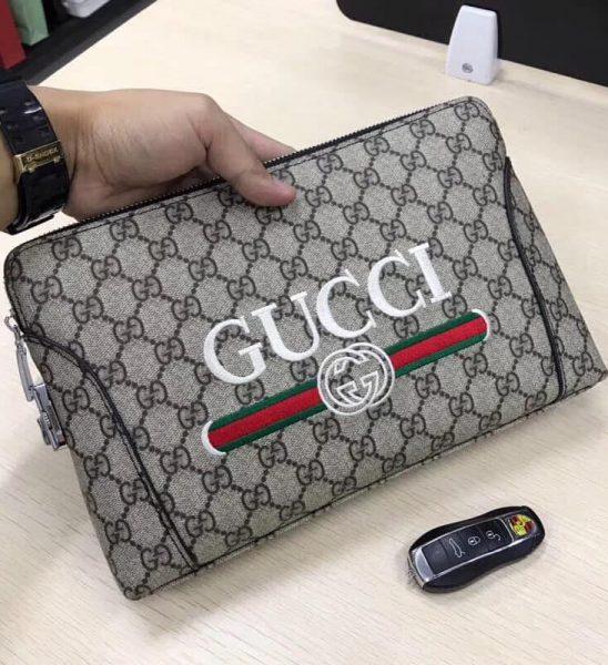 Ví nam cầm tay Gucci siêu cấp caro họa tiết logo