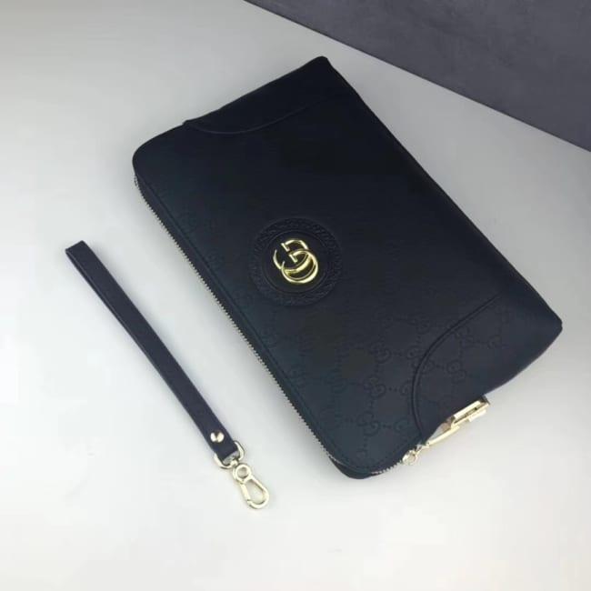 Ví nam Gucci siêu cấp cầm tay họa tiết logo chìm